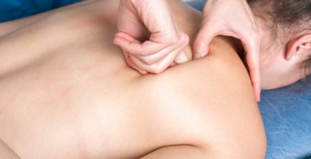 osteopath massaging back