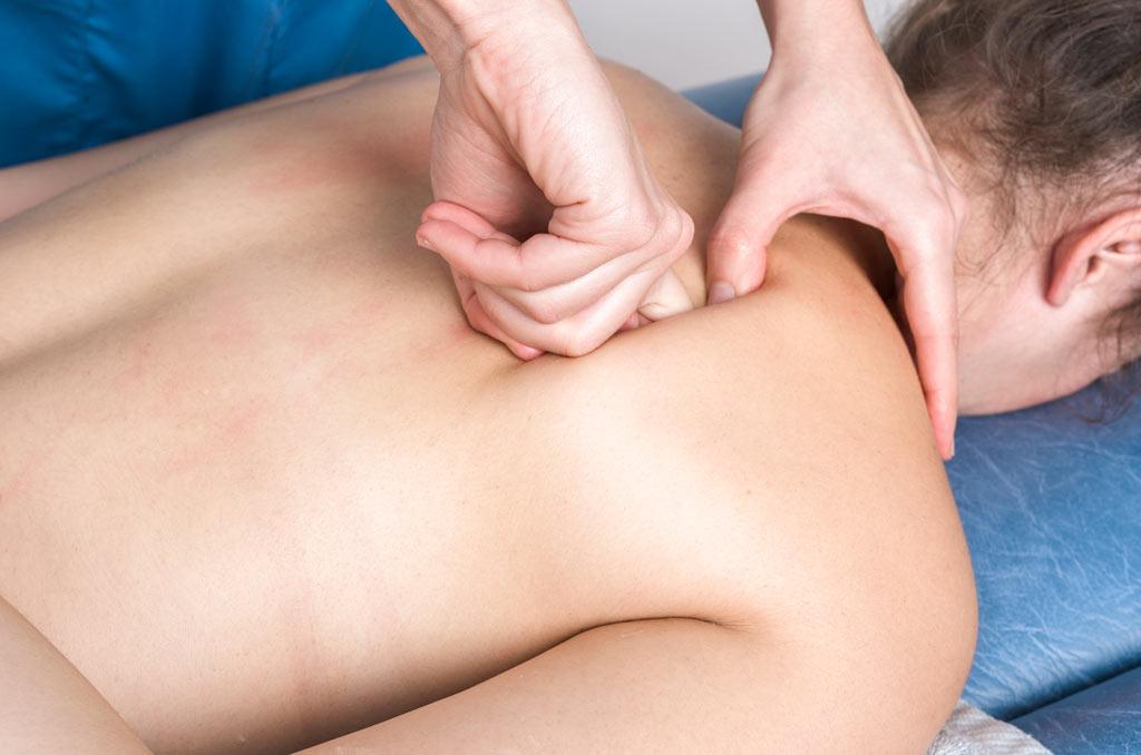 osteopath massaging back