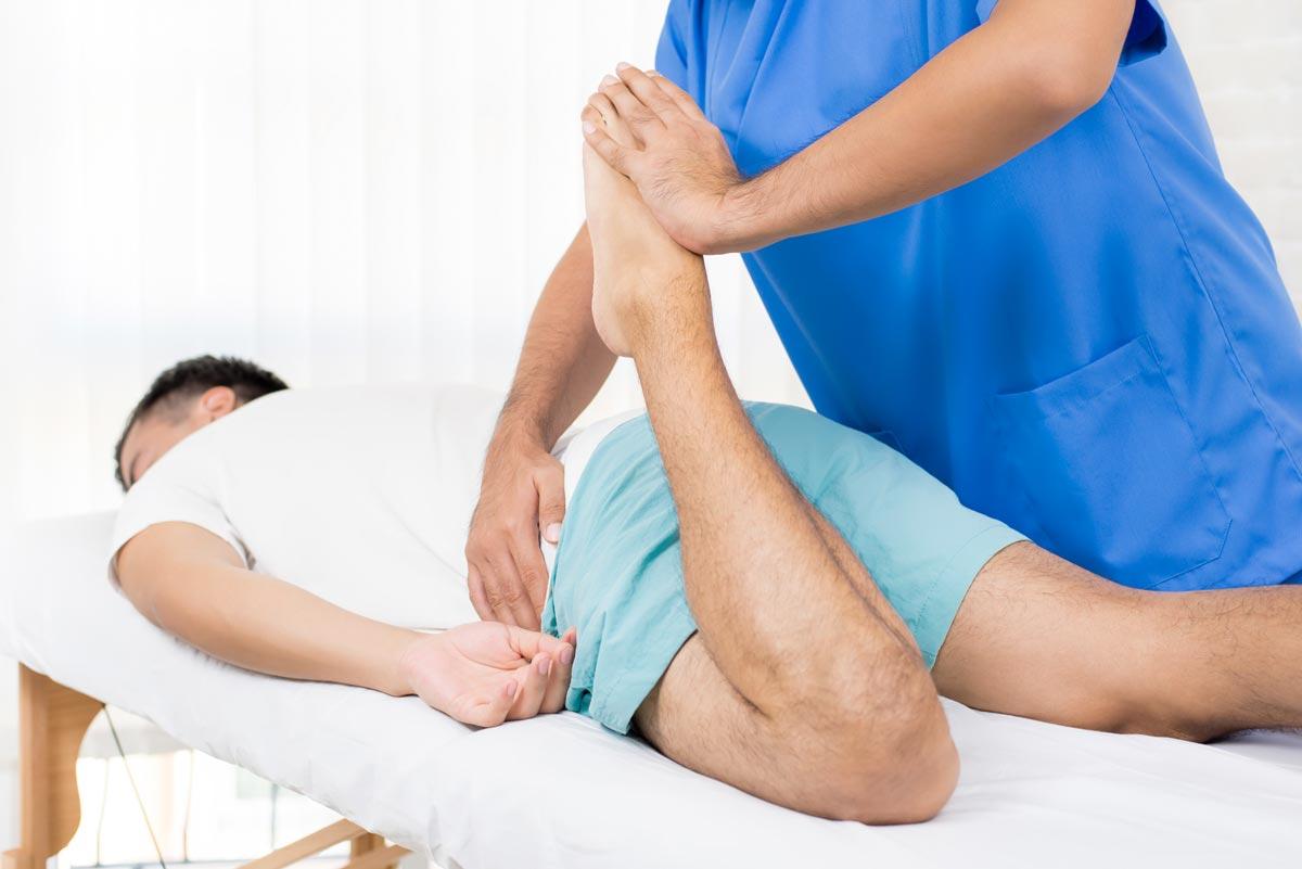 osteopath stretching leg
