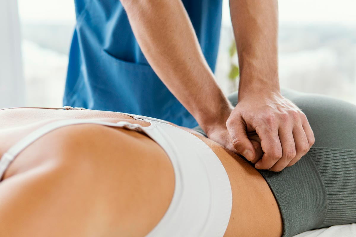 osteopath seeing patient for lower back pain